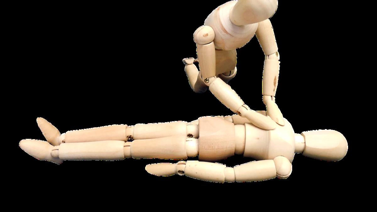 Gliederpuppen aus Holz demonstrieren Herzdruckmassage Rescue Aid